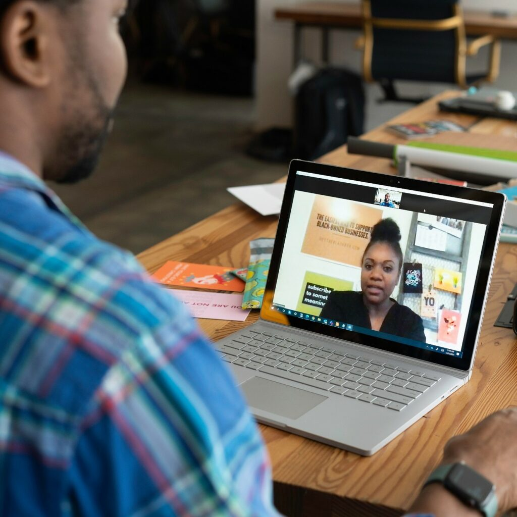 African intern speaks to his host company supervisor via Zoom.
